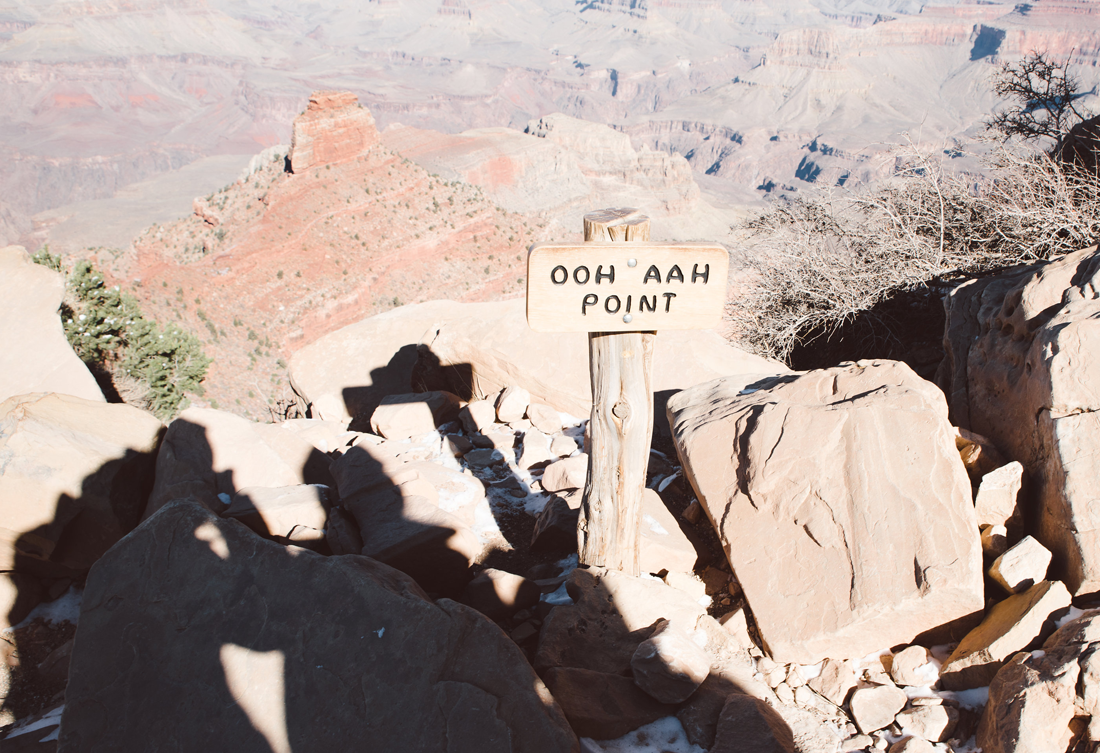 Women taking photo of Ooh Aah point at Grand Canyon