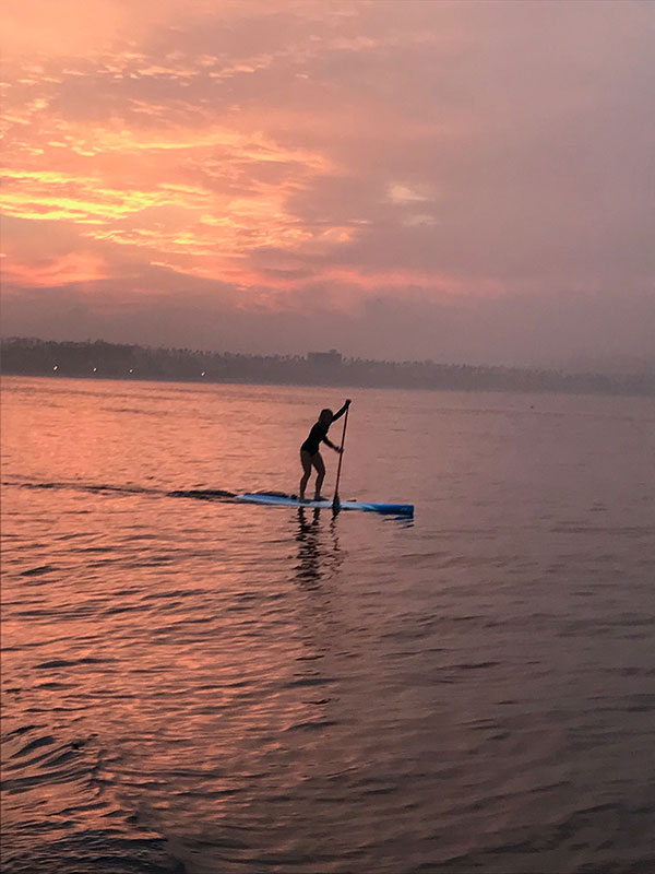 Sara Schulting Kranz on paddle board at sunset