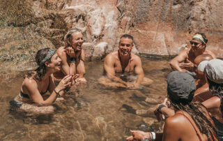group relaxing in a river